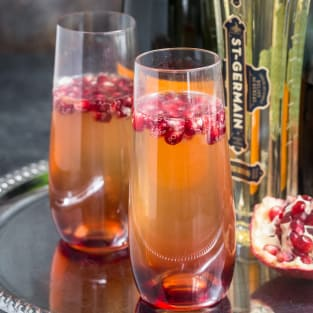 St germain and pomegranate champagne cocktail photo
