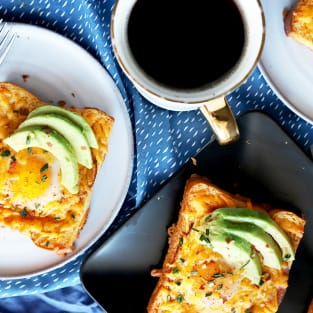 Cheesy avocado egg in a hole photo