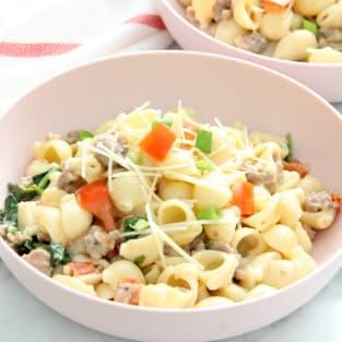 Creamy sausage and tomato pasta photo