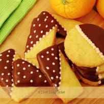 Decorated Orange Cookies Dipped in Chocolate