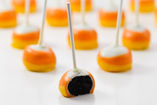Candy Corn Oreo Pops are a simple no-bake treat that are a hit with any crowd. Super easy to make with perfect Candy Corn layers!