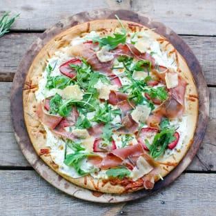 Prosciutto pizza with strawberries photo