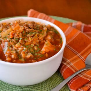 Stuffed cabbage soup with barley photo