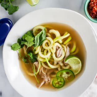 Thai chicken soup with zucchini noodles photo